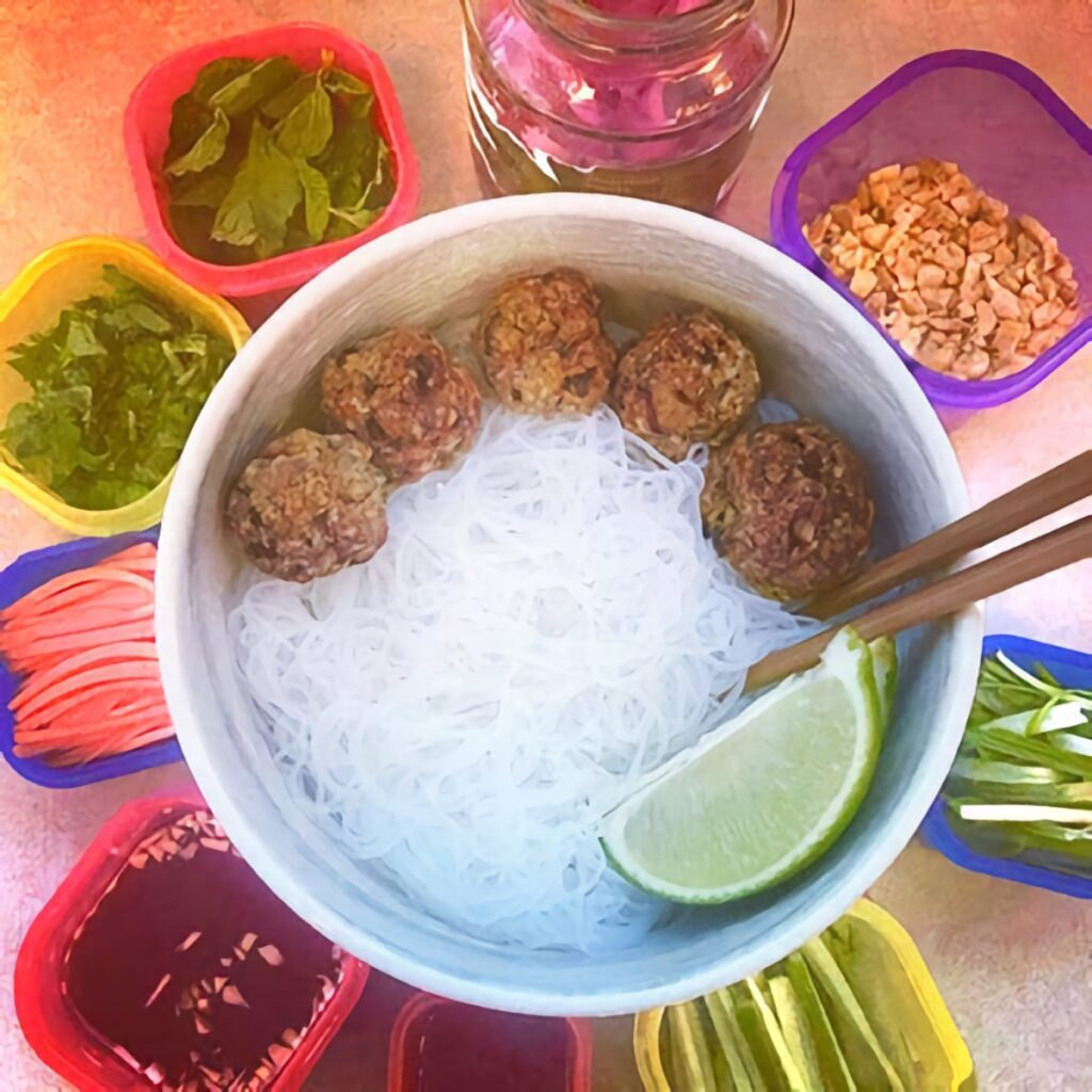 Bun Cha Vietnamese Meatball Noodle Bowl meal-prep, showing the various ingredients in small, bright containers.