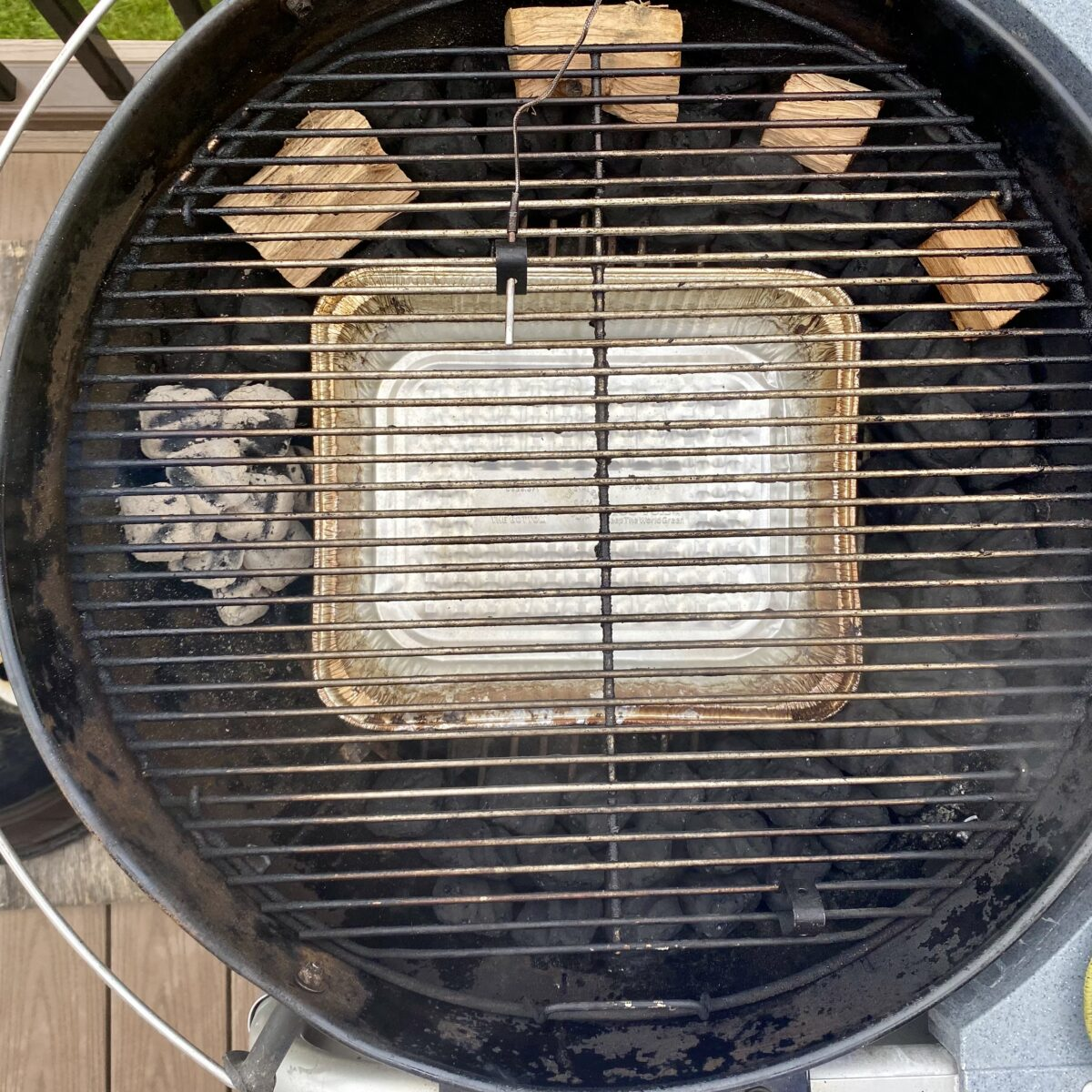 Overhead image showing grill temperature probe placement on the cooking grate.