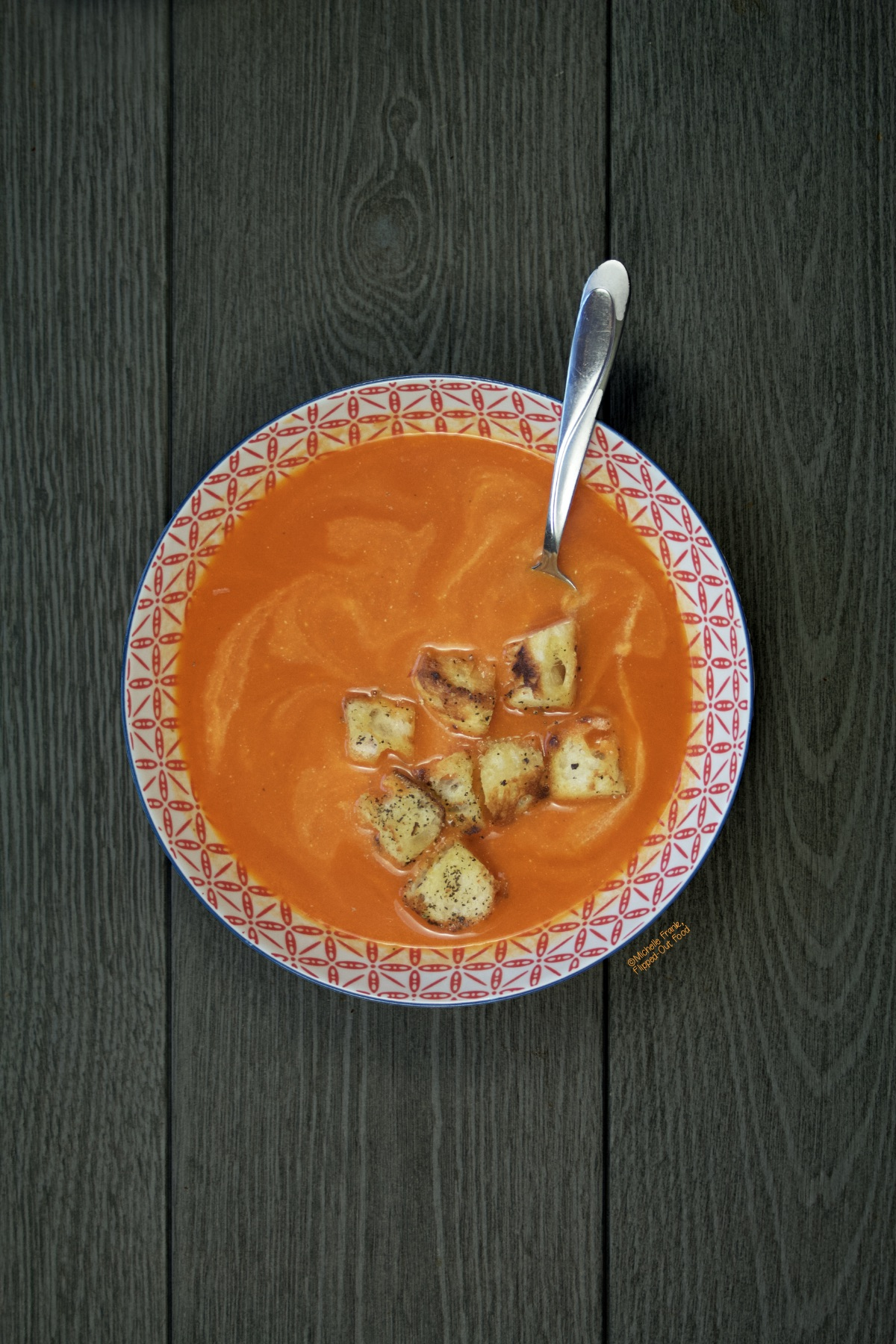 A bowl of Fresh Tomato Soup made creamy with ricotta cheese and topped with freshly made stove-top croutons.